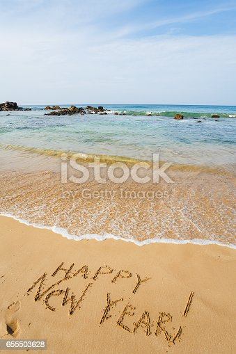 istock Happy New Year 2017 on the beach 655503628