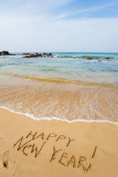 Happy New Year 2017 on the beach stock photo