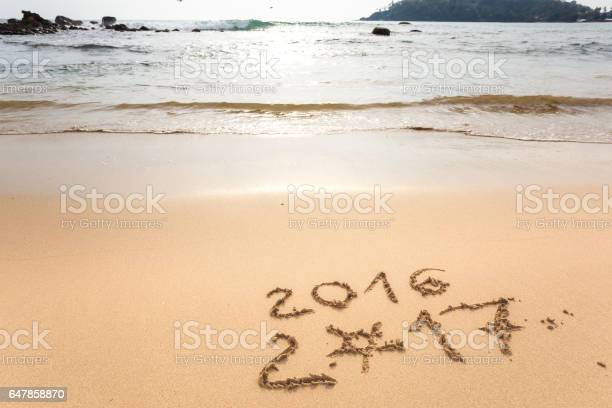 Happy New Year 2017 replace 2016, lettering on the beach