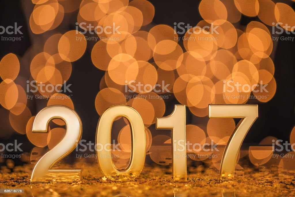 Happy New Year 2017 with gold lights bokeh background.
