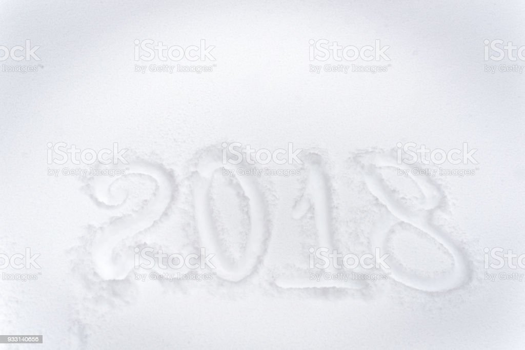 Happy new year 2018 celebration greeting card background. Message handwritten on the fresh snow stock photo