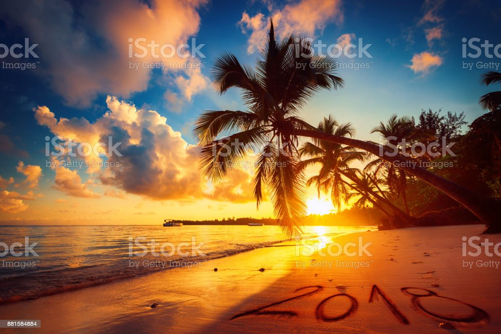 Happy New Year 2018 concept, lettering on the beach. Sea sunrise. Punta Cana stock photo