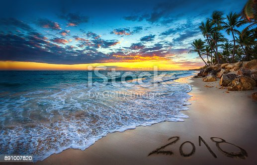 istock Happy New Year 2018 concept, lettering on the beach. Sea sunrise. Punta Cana. 891007820