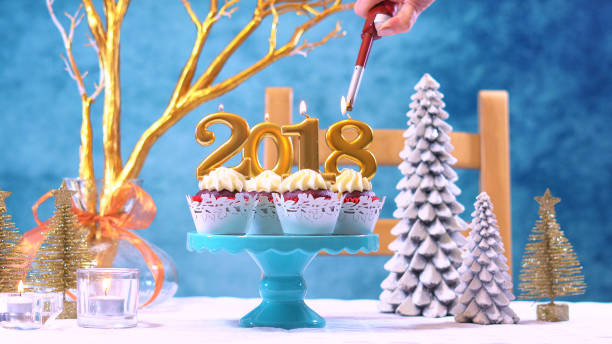 happy new year 2018 cupcakes - blue table setting stock photos and pictures