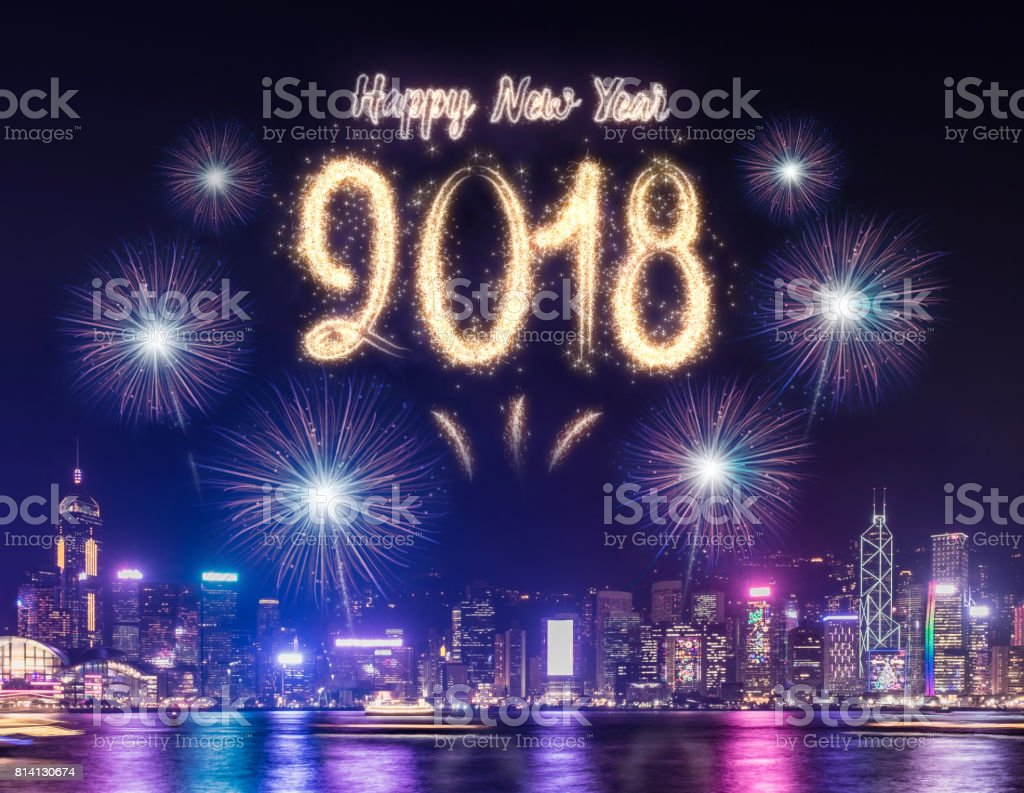 Happy new year 2018 firework over cityscape building near sea at night time celebration,Happy new year countdown. stock photo