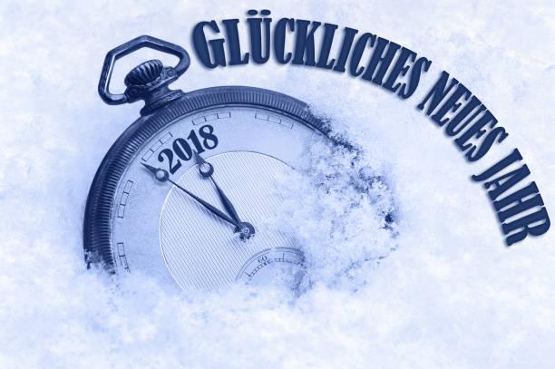 Royalty free pocket watch in snow happy new year greeting card happy new year 2018 greeting in german language gluckliches neues jahr text stock photo m4hsunfo