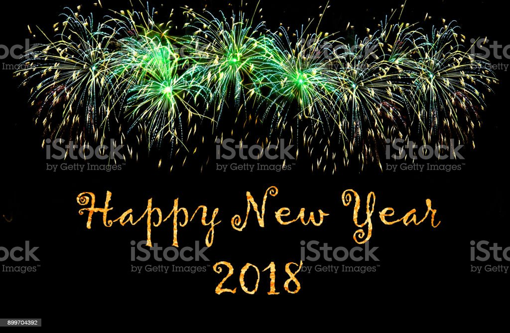 Happy New Year 2018 - greetings card with green fireworks stock photo