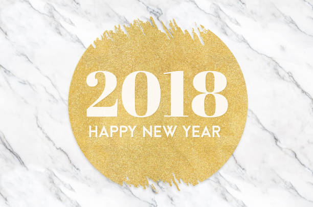 Happy new year 2018 number on gold circle glitter on white marble background,Holiday greeting card stock photo