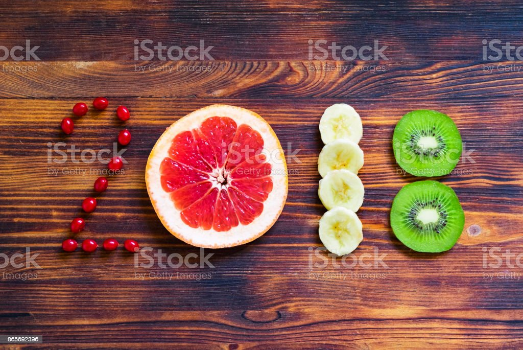 happy new year 2018 of fruit and berries on wooden background. stock photo