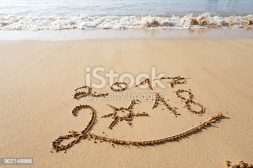 istock Happy New Year 2018 on the beach 902149988