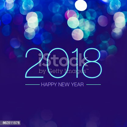 istock Happy new year 2018 with blue bokeh light sparkling on dark blue purple background,Holiday greeting card 862511578