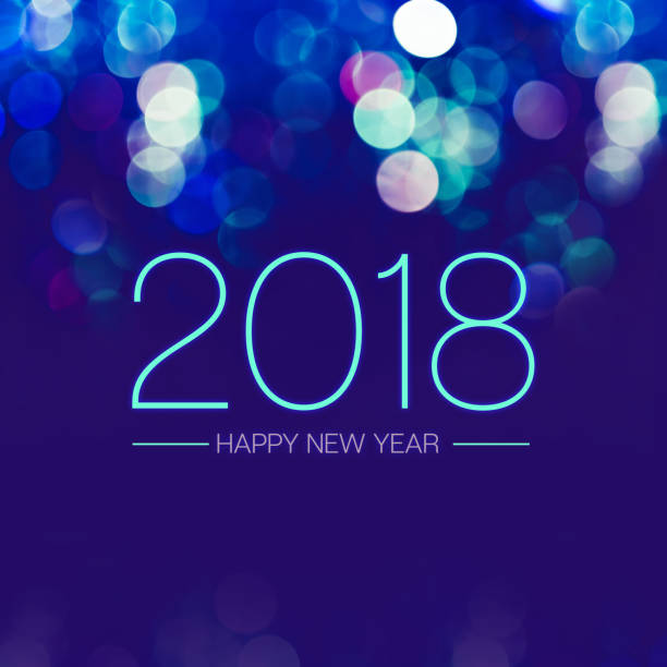 Happy new year 2018 with blue bokeh light sparkling on dark blue purple background,Holiday greeting card stock photo