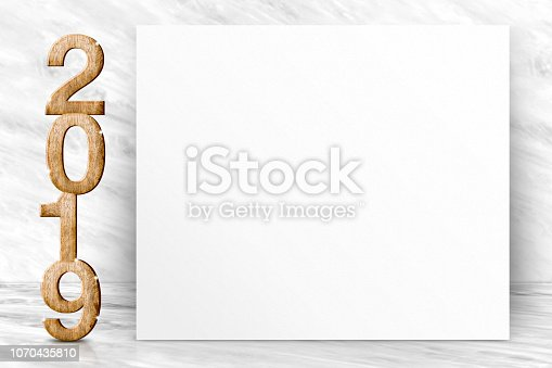 istock Happy new year 2019 3d rendering with blank white poster greeting card in perspective white marble studio room,leave space for display of design or content. 1070435810