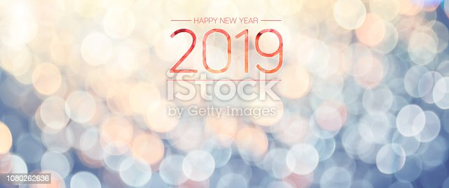 istock Happy new year 2019 banner with pale yellow and blue bokeh light sparkling background,Holiday greeting card. 1080262636