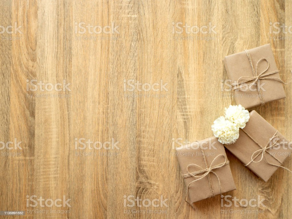 Gift wrapping compositi on homemade wrapped present boxes on wooden...