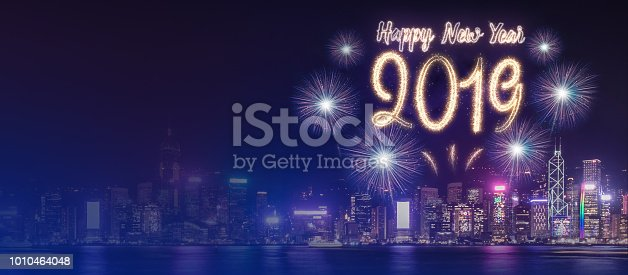 istock Happy new year 2019 firework over cityscape building near sea at night time celebration,mock up Banner for advertise on social media. 1010464048
