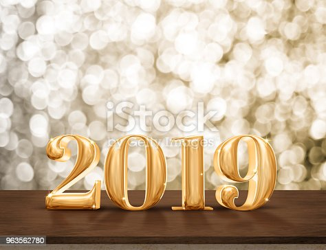 istock Happy New Year 2019 gold glossy with sparkling star on dark brown table with gold bokeh wall,Holiday festive celebration concept.copy space for display of text or content. 963562780