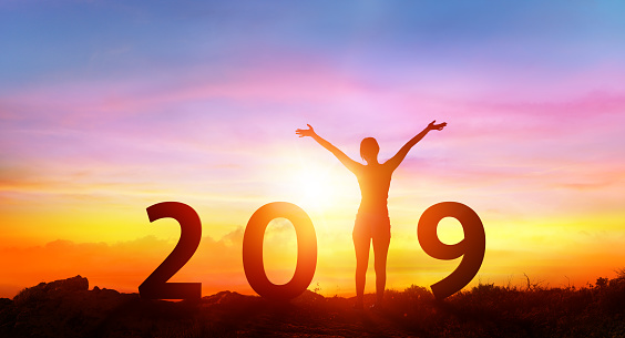 istock Happy new year 2019 - Happy Girl With Numbers At Sunrise 1047778450