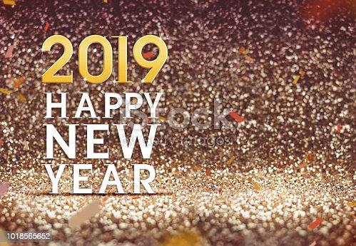 istock Happy New year 2019 in gold color abstract glitter background, Holiday concept design,Leave space for adding your content. 1018565652