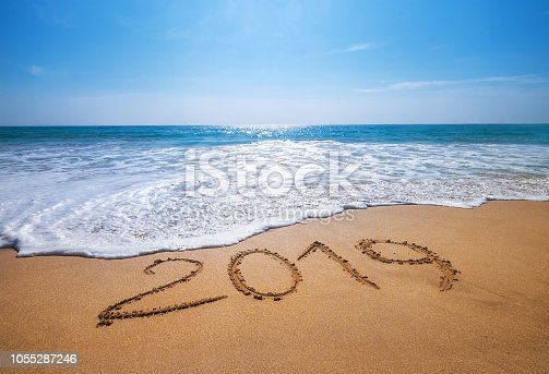 Happy New Year 2019 is coming concept sandy tropical ocean beach lettering concept image and