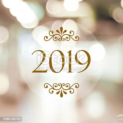 istock Happy New Year 2019 on blur abstract bokeh background, new year greeting card, banner 1030135702