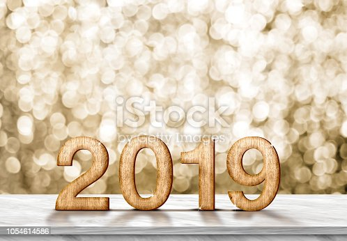 istock Happy new year 2019 (3d rendering) on grey marble table at gold sparkle bokeh abstract background,holiday greeting card. 1054614586