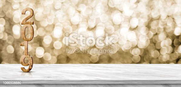 istock Happy new year 2019 (3d rendering) on grey marble table at gold sparkle bokeh abstract background,mock up banner holiday greeting card. 1066508880
