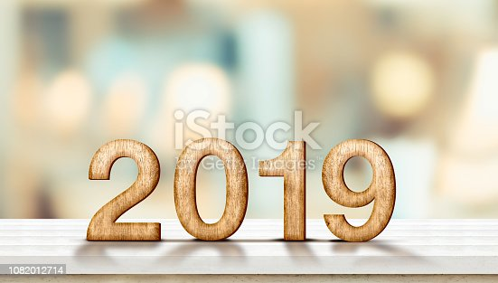 istock Happy new year 2019 on marble table with pale soft bokeh wall,banner for display or montage of product for holiday promotion and advertise for online content 1082012714