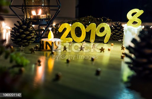 1034181324istockphoto Happy New Year 2019, Symbol from number 2019 on wooden background. 1063201142