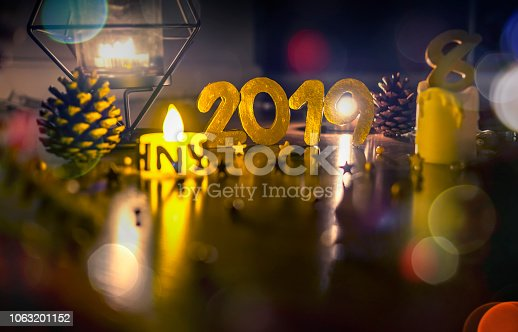 1034181324istockphoto Happy New Year 2019, Symbol from number 2019 on wooden background. 1063201152
