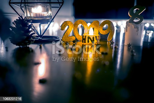 1034181324istockphoto Happy New Year 2019, Symbol from number 2019 on wooden background. 1063201216