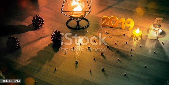 1034181324istockphoto Happy New Year 2019, Symbol from number 2019 on wooden background. 1063201244