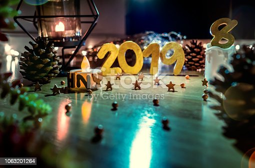 1034181324istockphoto Happy New Year 2019, Symbol from number 2019 on wooden background. 1063201264