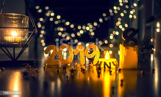 1034181324istockphoto Happy New Year 2019, Symbol from number 2019 on wooden background. 1063201302