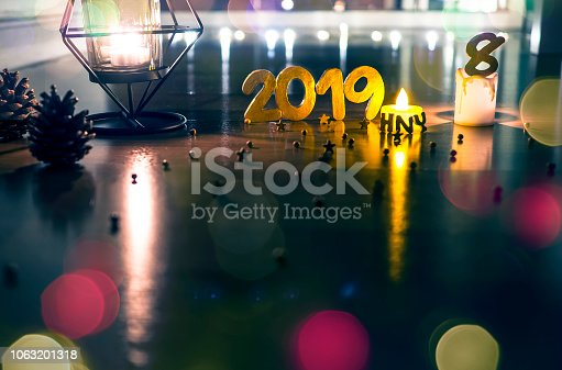 1034181324istockphoto Happy New Year 2019, Symbol from number 2019 on wooden background. 1063201318