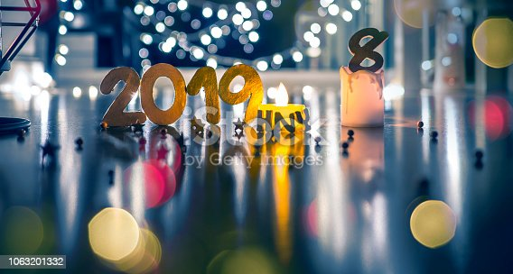 1034181324istockphoto Happy New Year 2019, Symbol from number 2019 on wooden background. 1063201332