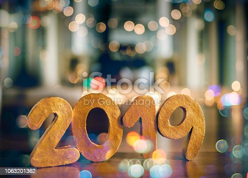 1034181324istockphoto Happy New Year 2019, Symbol from number 2019 on wooden background. 1063201362