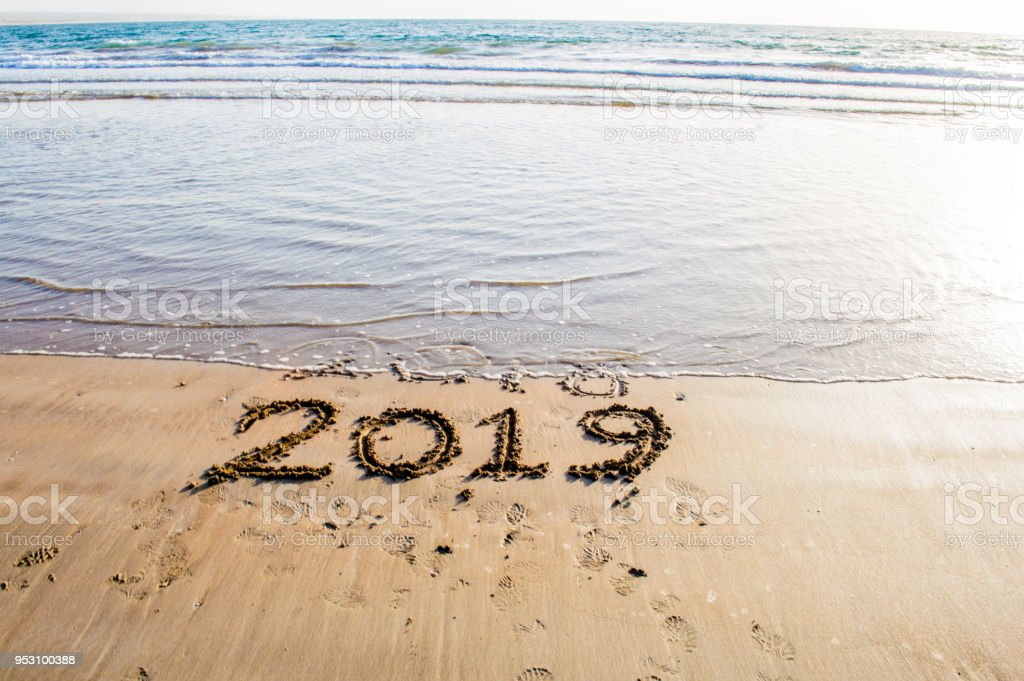 happy new year 2019 text on the sea beach abstract background photo of coming new