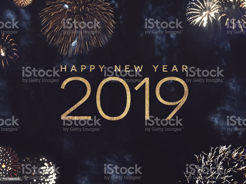 Happy New Year 2019 Text with Gold Fireworks in Night Sky stock photo