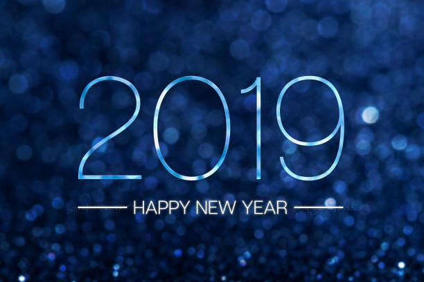 Happy new year 2019 with dark navy blue glitter bokeh light sparkling background,Holiday celebration festive greeting card. Happy new year 2019 with dark navy blue glitter bokeh light sparkling background,Holiday celebration festive greeting card new year's eve stock pictures, royalty-free photos & images