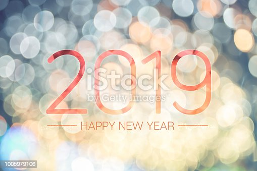 istock Happy new year 2019 with pale yellow bokeh light sparkling background,Holiday greeting card. 1005979106