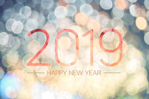 Happy new year 2019 with pale yellow bokeh light sparkling background,Holiday greeting card. stock photo