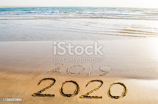 istock Happy New Year 2020 beach picture image abstract background 1158452994