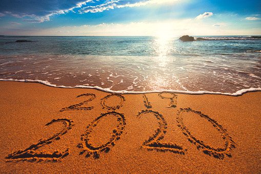 istock Happy New Year 2020 concept, lettering on the beach. Sea sunrise 1191283928