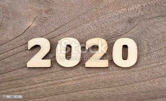 1018565666 istock photo Happy New Year 2020 concept, Wood 2020 on wooden background 1186219299
