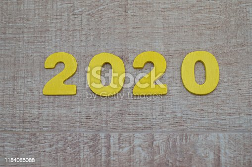 1018565666istockphoto Happy New Year 2020 concept, Wood block 2020 on wooden background 1184085088