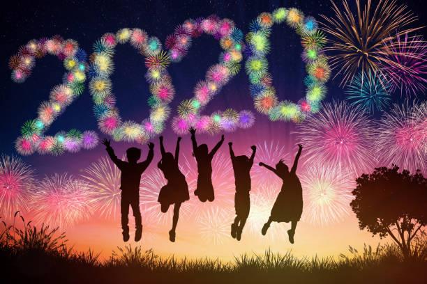 happy new year 2020 concepts. children jumping on hill - happy 4th of july zdjęcia i obrazy z banku zdjęć