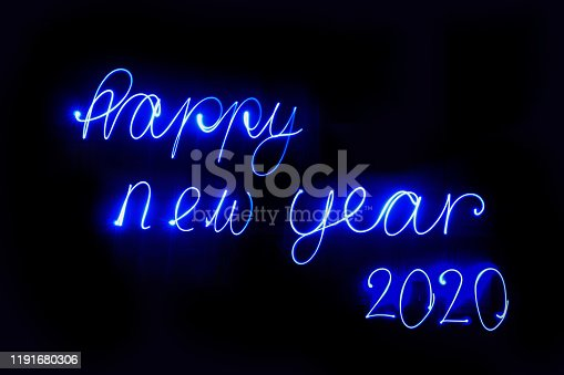 Light painting 2020 Numbers with black background. Coloured Blue lights used to write numbers. Happy New Year Celebrations