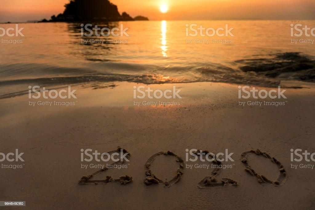 Happy New Year 2020 on Beach stock photo