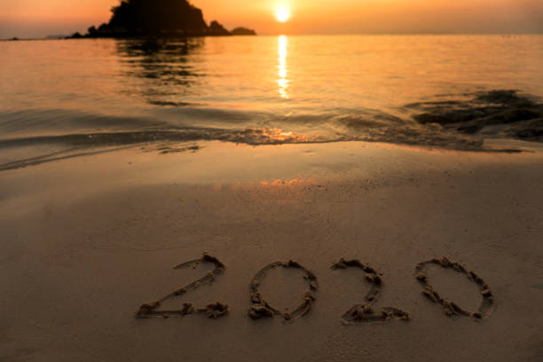Happy New Year 2020 on Beach stock photo